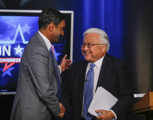 Democratic challenger Ro Khanna and Rep. Mike Honda shake hands after their general-election debate in 2014.