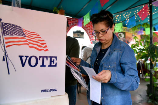 Rosa Ayala checks her ballot after voting in the US presidential primary June 7, 2016 in Los Angeles.