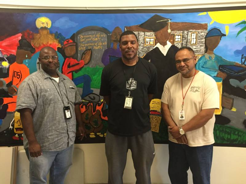 Mike Texada (left) of The Wraparound Project stands with James Caldwell (center) and Joseph Kaulave (right) from the Street Violence Intervention Program. After a violent crime, their teams work together to prevent future injury for individuals and communities.