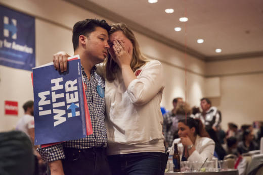 Clinton supporters comfort each other during the Hillary Clinton Watch party in San Francisco, California on November 8, 2016.