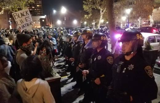 A crowd of protesters meets a line of police officers during demonstrations in downtown Oakland on Nov. 9 following the election of Donald Trump.