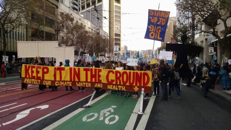A protest over the Dakota Access Pipeline marches down Market Street in San Francisco.