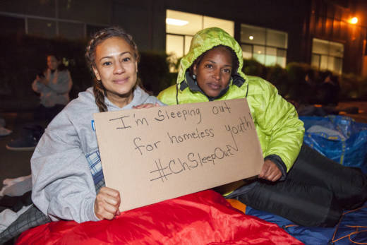 Tasha Henneman (left) and Nichelle Kitt hold for a photo before tucking into their sleeping bags during Covenant House Oakland's Sleep Out.