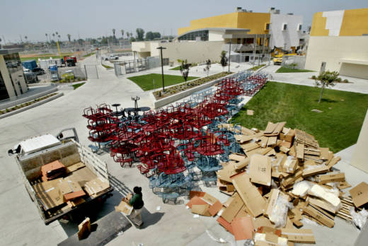 A worker recycles cardboard boxes during the construction of Santee High School in South Los Angeles, which opened in 2005 as the first high school built in 35 years in the nation's second-largest district.