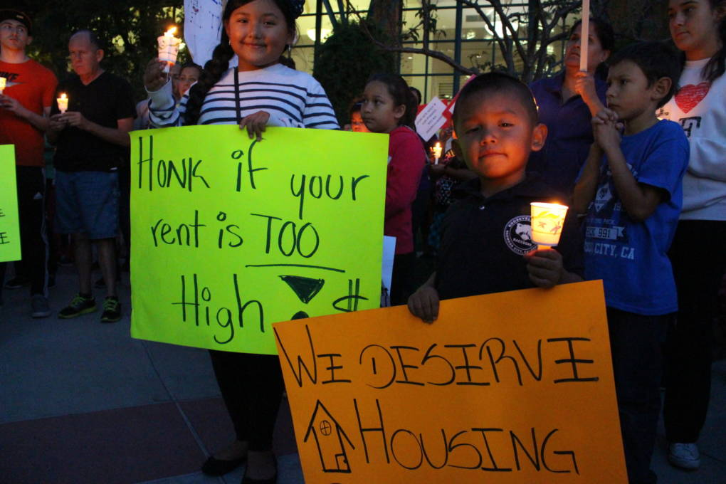 Giselle Penuela, 10, and Alexander Penuela, 6 attend an October 2015 vigil in Redwood City outside the City Council chamber calling for rent control and other renter protections.