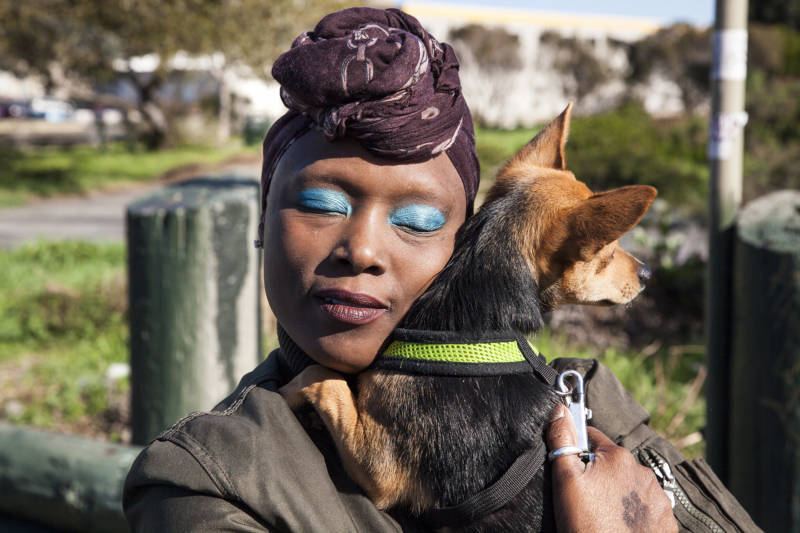 "Jernika Robinson hugs her dog King after his check up at the Vet S.O.S clinic in San Francisco, California. Robinson was relieved to have a clean bill of health for her puppy. ""We do everything together."" Say Robinson as she hugs King."
