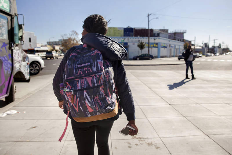 Brittany Jones, a student at Laney College, makes her way from class to her storage unit in West Oakland. Jones is currently homeless and spends up to three hours a day at her storage unit organizing her belongings, doing homework, or relaxing.