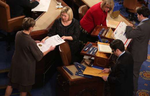 Congressional clerks help unseal and organize the Electoral College votes from all 50 states in the U.S. House of Representatives on January 4, 2013.