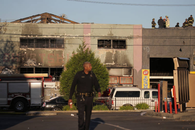 Firefighters and police at the scene of a overnight fire that claimed the lives of at least nine people at a warehouse in the Fruitvale neighborhood on December 3, 2016 in Oakland, California. The warehouse was hosting an electronic music party.