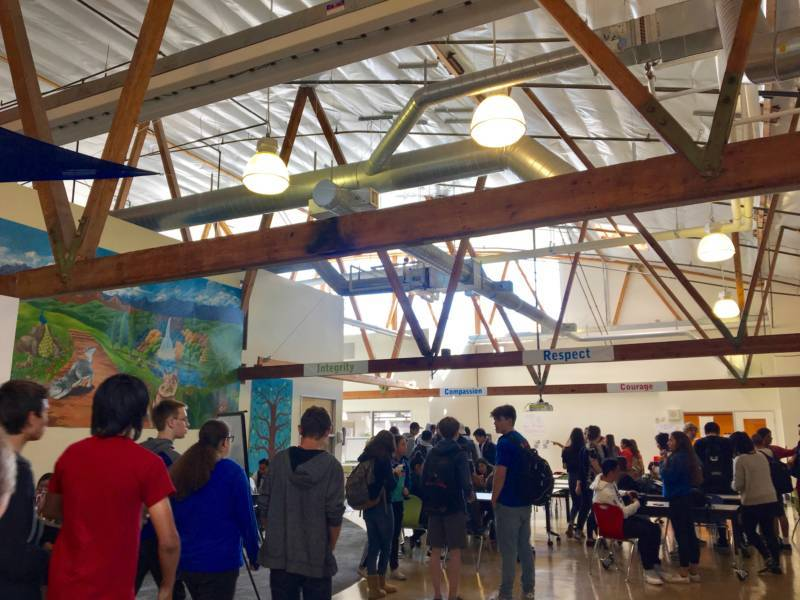 Students mill about the atrium of Summit Prep in Redwood City.