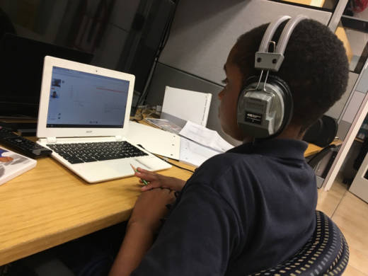A student works with an online tutor at the Skid Row storefront where School on Wheels — which provides academic support and school supplies to homeless kids — runs an after-school program.
