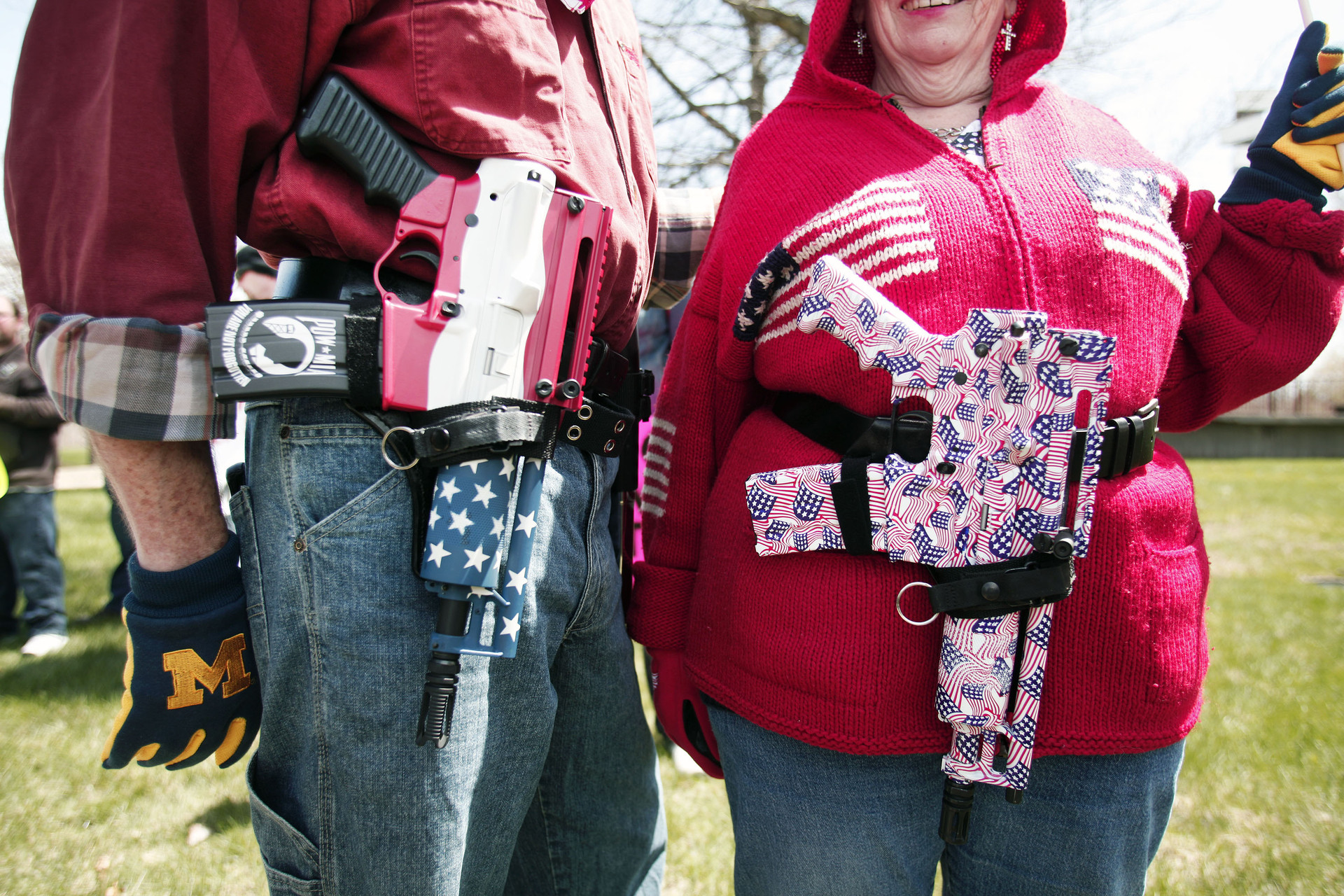 A couple carry decorated Olympic Arms .223 pistols at a rally for supporters of Michigan's open carry law.