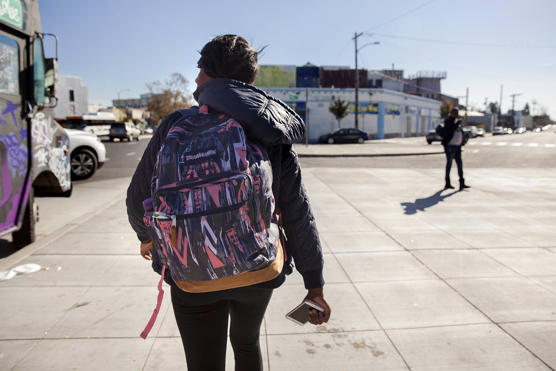 Brittany Jones, a student at Laney College, makes her way from class to her storage unit in West Oakland. Jones is currently homeless and spends up to three hours a day at her storage unit organizing her belongings, doing homework or relaxing. Brittany Hosea-Small/KQED