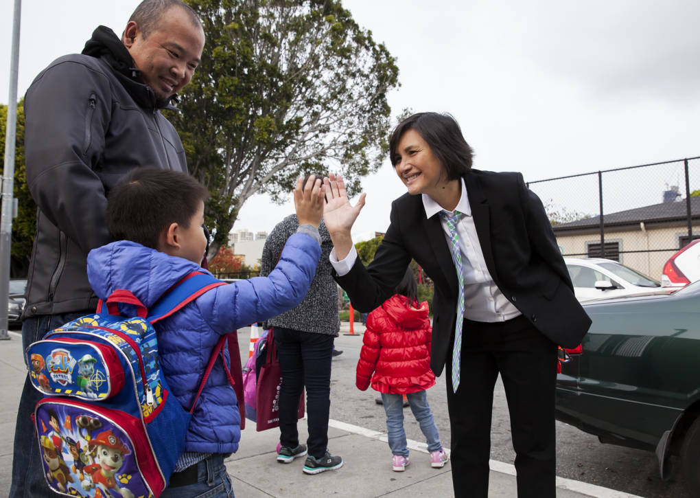 Tina Lagdamen, the Principal at Bessie Carmichael Elementary School in San Francisco, says goodbye to each of her students at the end of the school day with a high-five and a smile.
