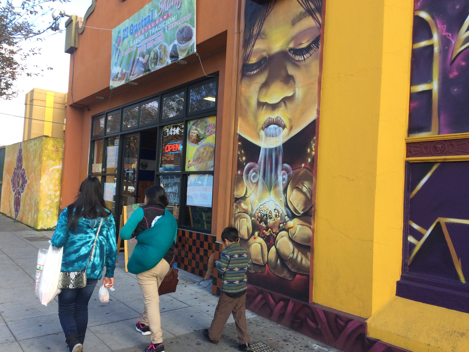 A mural by the Eastside Arts Collective is one of many that decorate stores and other buildings on Fruitvale Ave. The neighborhood has become home to many artists, say long time residents.