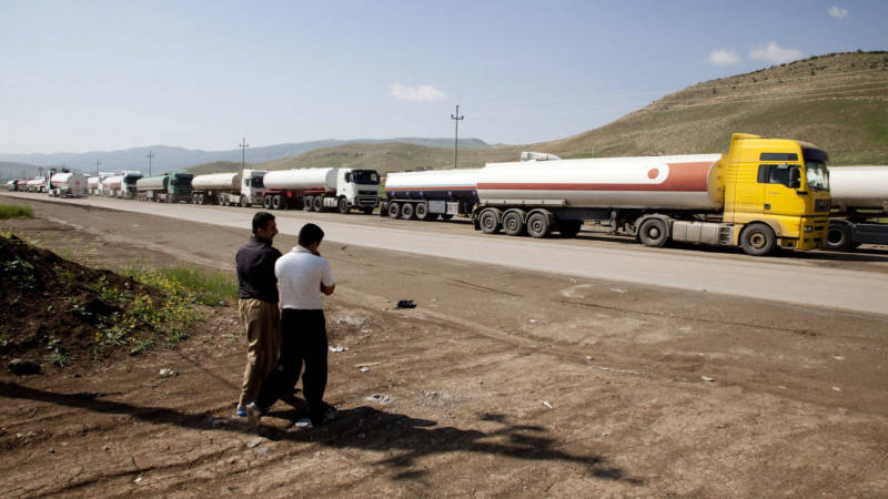 Oil trucks line up in April 2013 at the Bazian refinery near the city of Sulaymaniyah in the semi-autonomous Kurdish region of northern Iraq. ExxonMobil was one of several oil companies to negotiate with the regional government, despite opposition from Baghdad and the United States.