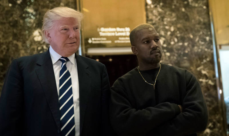 President-elect Donald Trump and Kanye West pose for a picture Tuesday in the lobby of Trump Tower in New York.