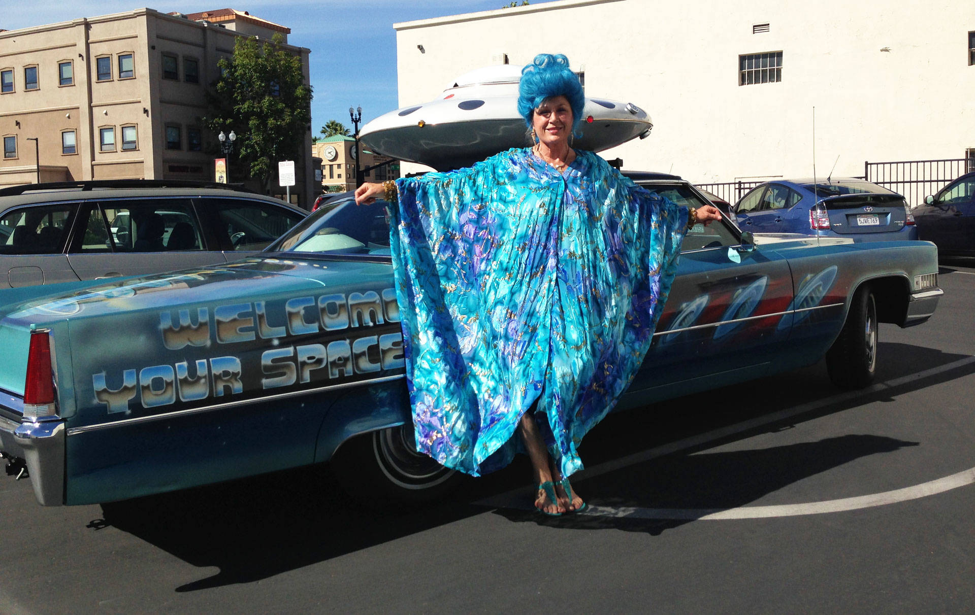 Unarian Lani Calvert with the Academy's '69 Cadillac, modified with a custom saucer. Peter Gilstrap/KQED