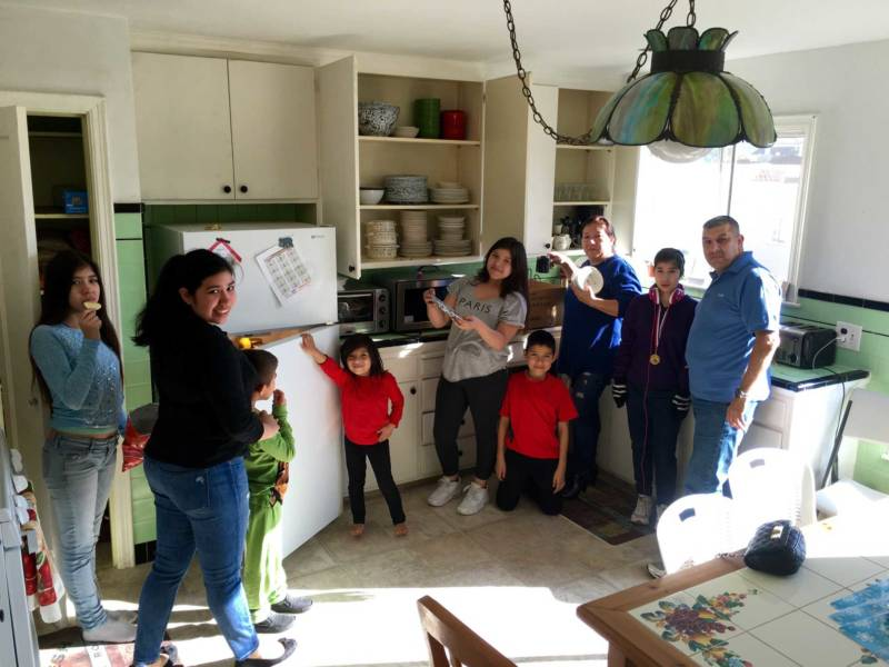 The Aucar family in their new Daly City home.