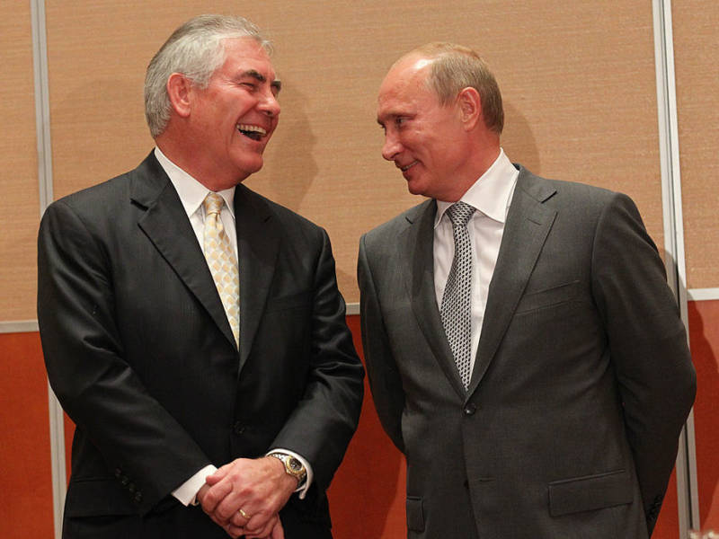 Russian President Vladimir Putin and Rex Tillerson, chairman and CEO of Exxon Mobil, share a laugh during a signing ceremony for an arctic oil exploration deal between Exxon Mobil and Rosneft in August 2011.