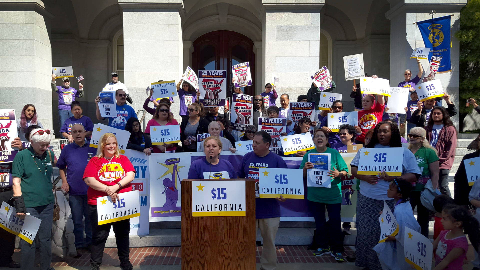 Supporters of a $15 per hour minimum wage rally outside the state Capitol in Sacramento on March 31, 2016. Katie Orr/KQED