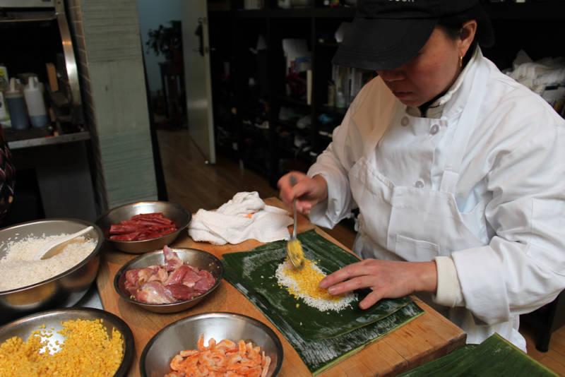 Xing Huang helps prepare banh chưng.