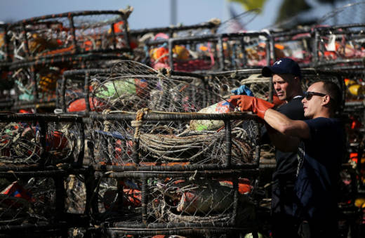 Chris Swim (R) and Nick White repair crab traps in Half Moon Bay.