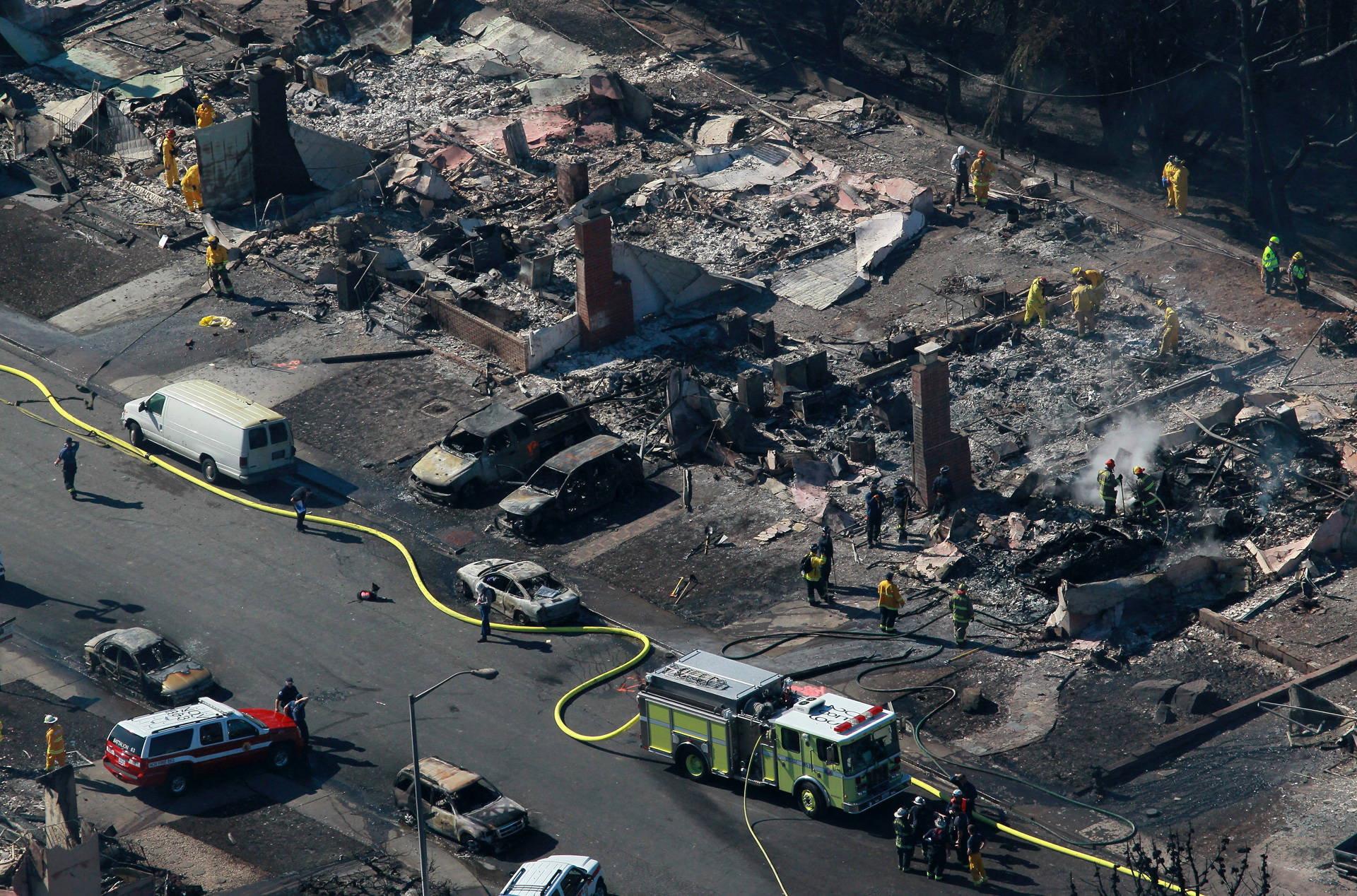Firefighters mop up hot spots near homes destroyed by the massive gas pipeline explosion and fire on Sept. 9, 2010 in San Bruno. Justin Sullivan/Getty Images