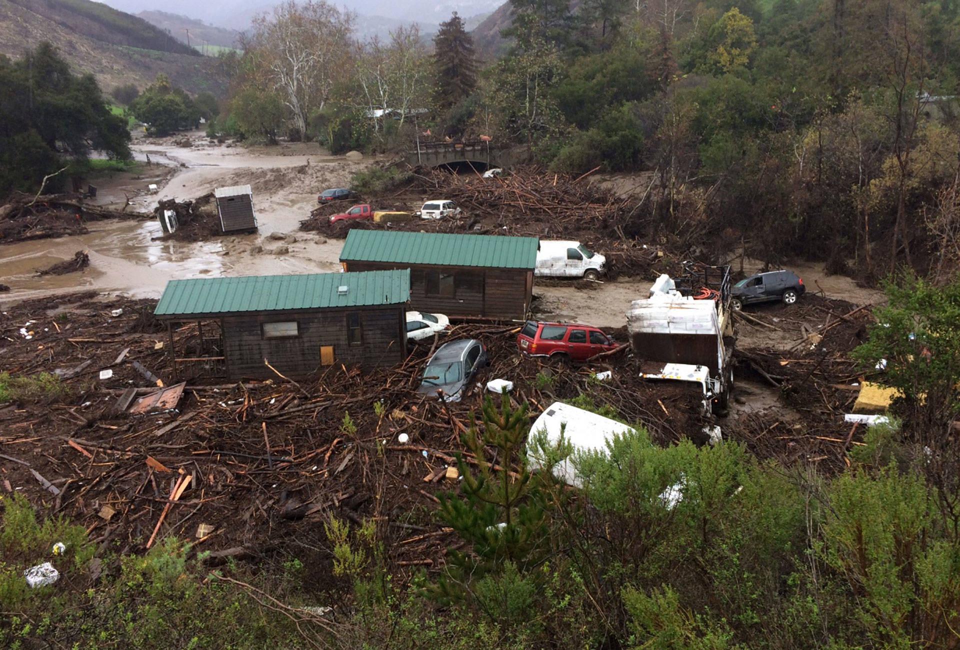 flood sweeps vehicles and cabins down canyon near santa