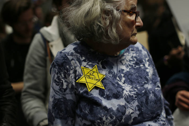 SAN FRANCISCO, CA - JANUARY 28: A woman wears a pin during a rally against muslim immigration ban at San Francisco International Airport on January 28, 2017 in San Francisco, California. President Donald Trump signed an executive order Friday that suspends entry of all refugees for 120 days, indefinitely suspends the entries of all Syrian refugees, as well as barring entries from seven predominantly Muslim countries from entering for 90 days. (Photo by Stephen Lam/Getty Images)