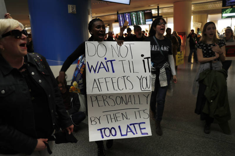 SAN FRANCISCO, CA - JANUARY 28: Demonstrators march into the international arrival area during a rally against muslim immigration ban at San Francisco International Airport on January 28, 2017 in San Francisco, California. President Donald Trump signed an executive order Friday that suspends entry of all refugees for 120 days, indefinitely suspends the entries of all Syrian refugees, as well as barring entries from seven predominantly Muslim countries from entering for 90 days. (Photo by Stephen Lam/Getty Images)