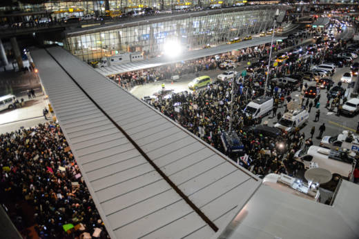 Protestors rally during a demonstration against the new immigration ban issued by President Donald Trump at John F. Kennedy International Airport on January 28, 2017 in New York City. President Trump signed the controversial executive order that halted refugees and residents from predominantly Muslim countries from entering the United States.