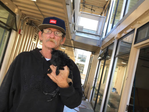 Jimmy Palmiter, 59, a Vietnam-era veteran, visits the unfinished apartments at the Potter's Lane housing project in Midway City, Orange County. After being homeless for nearly five years in Southern California, he said he's looking forward to the permanent housing. 'It's time for me to get off the street,' he said.