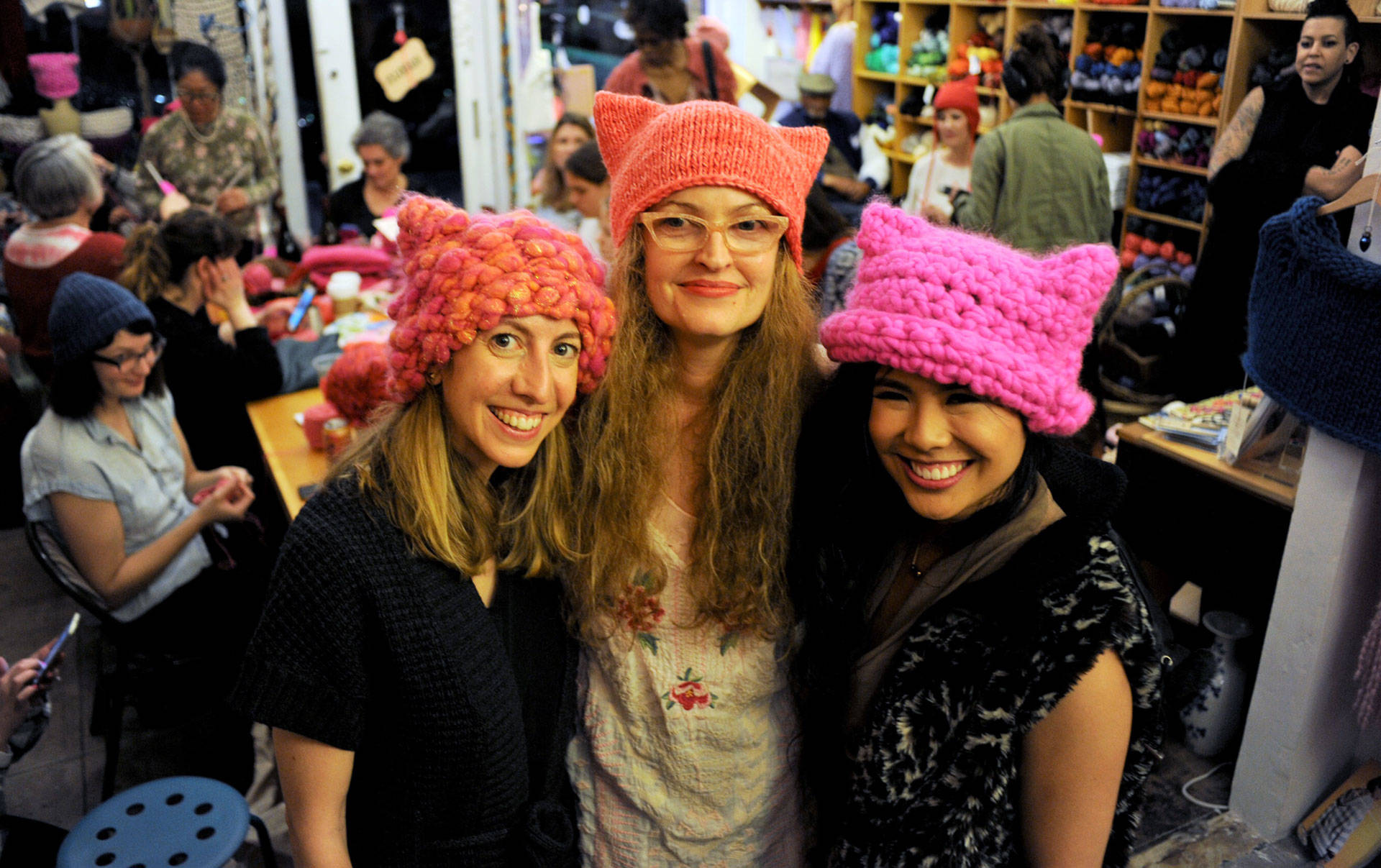 Pussyhat Project co-founder Jayna Zweiman (L), The Little Knittery owner Kat Coyle (C), and Pussyhat Project co-founder Krista Suh (R) at The Little Knittery in Los Angeles. Blair Wells/KQED
