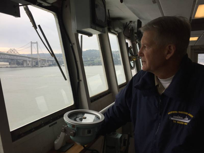 Training Ship Golden Bear's Captain Harry Bolton looks out from the ship's bridge.