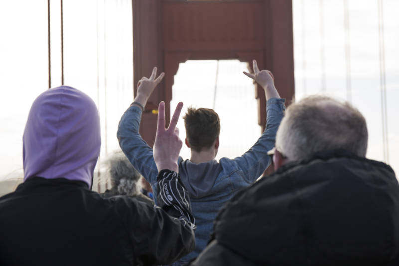 Protestors gathered across the Golden Gate Bridge at about 10 a.m. on Jan. 20, 2017. The participants linked hands while cheering and wearing purple. Their demonstration acted as a message against President Donald Trump.