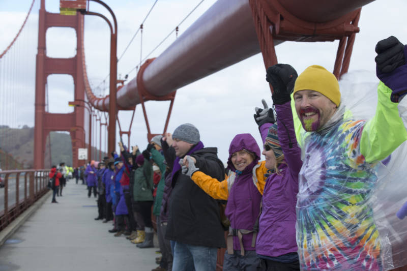 Protestors gathered across the Golden Gate Bridge at about 10 a.m. on Jan. 20, 2017. The participants linked hands while cheering and wearing purple. Their demonstration acted as a message against President Donald Trump on the day of his inauguration.