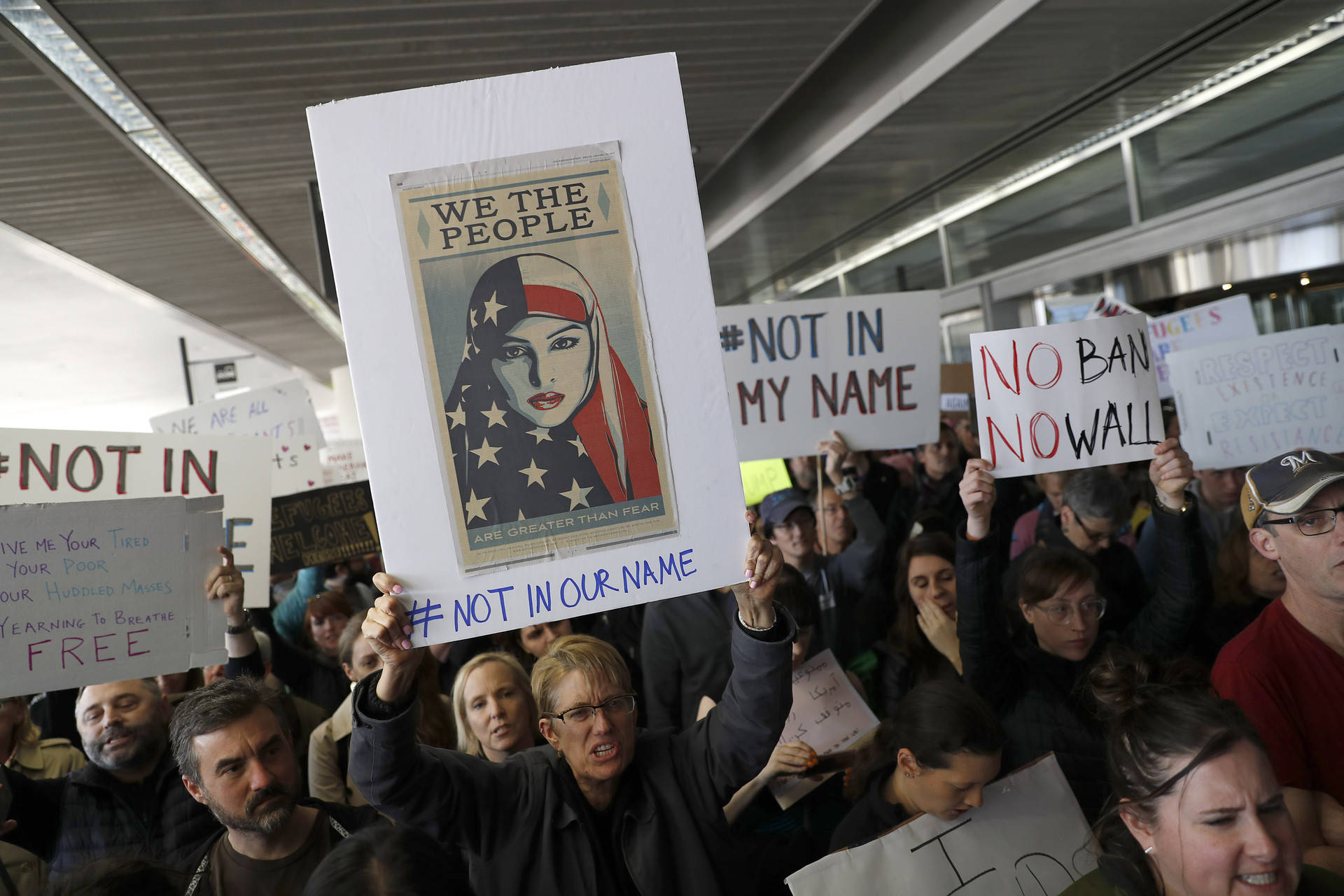 Demonstrators march at SFO to protest President Trump's new immigration policies.  Stephen Lam/Getty Images