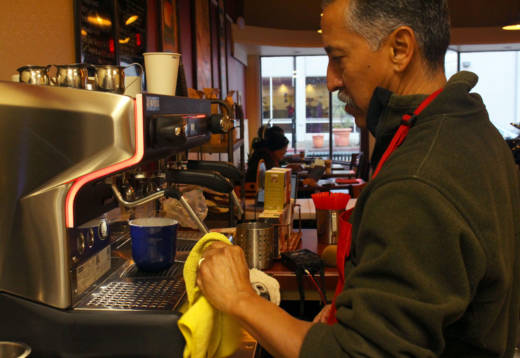 Richard Santana works the espresso machine at his cafe in Oakland's Laurel district on Jan. 18, 2017. In his bid to open his business, Santana said he spent personal funds and incurred credit card debt before he was able to secure a loan.