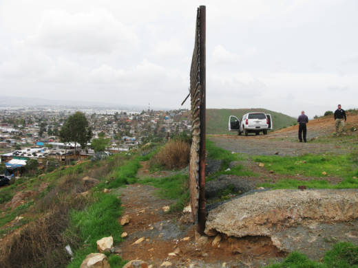 This fence, made of circa-Vietnam War era surplus landing mats, ends at Otay Mesa about 15 miles east of the Pacific Ocean. Tijuana is on the left and California on the right. There are two other kinds of fencing along the U.S.-Mexico border: steel mesh and concrete-filled steel beams.
