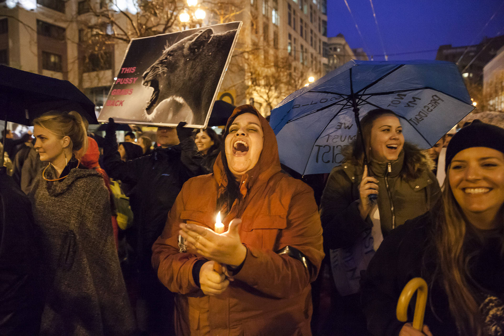"""Nicole Barnes (center) chants with other protesters as she carries a candle during the Women's March in San Francisco on Jan. 21, 2017. """"We are not invisible, and nobody is going to speak for us,"""" Barnes says. """"We have a voice. We've had it the whole time."""" Brittany Hosea-Small/KQED"""