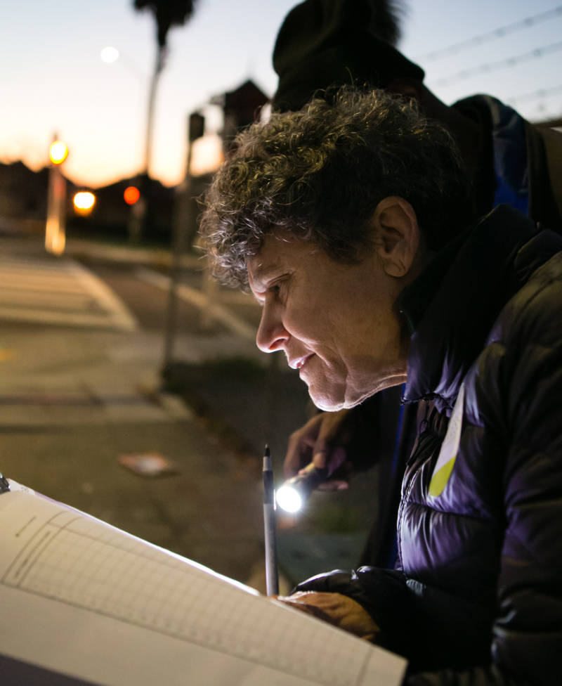 Brenda Goldstein of El Cerrito fills out survey forms during the Alameda County Point-In-Time homeless survey on Jan. 31, 2017.