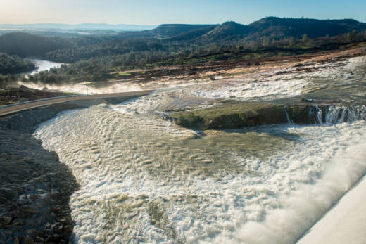 Water flows down the auxiliary spillway at Oroville Dam on Saturday.