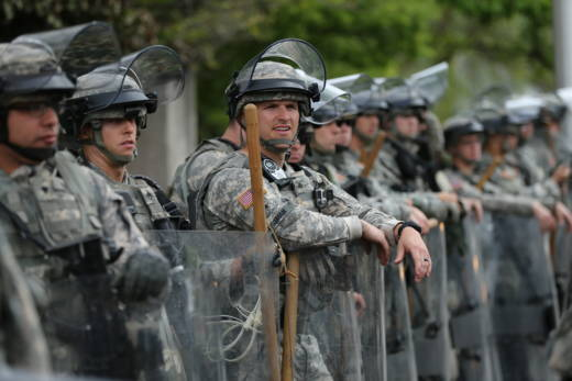 National Guard troops keep watch on May 1, 2015 in Baltimore, Maryland.