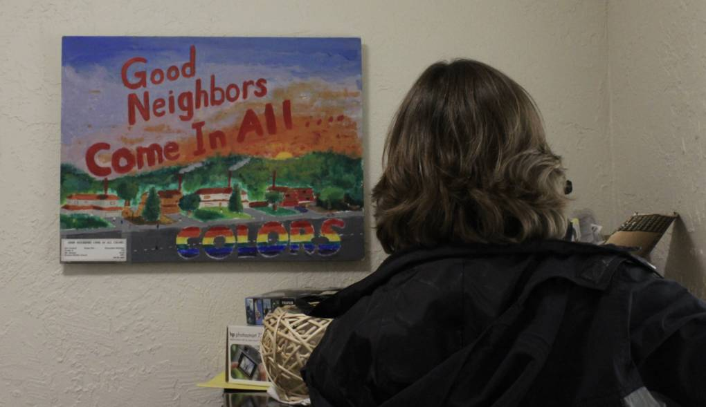 "A painting that reads ""Good neighbors come in all colors"" hangs in the office at Fair Housing Advocates of Northern California, which was formerly known as Fair Housing of Marin."