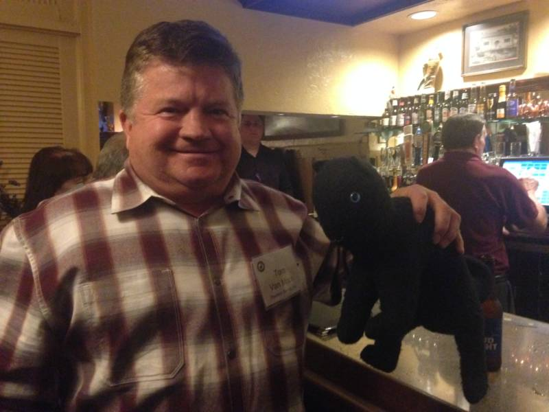 Tom Von Moos and a stuffed black cat.