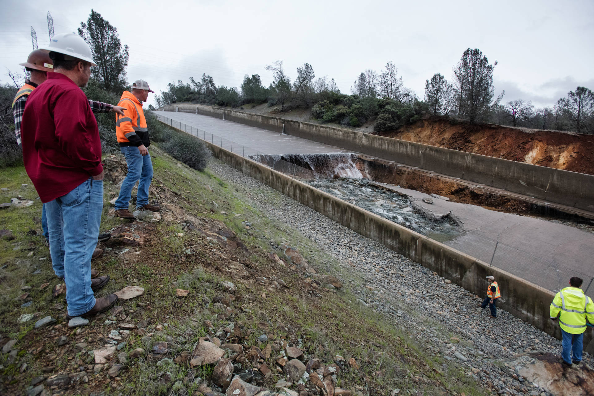California Department of Water Resources workers inspected damage to the spillway at Oroville Dam after a breach appeared on Feb. 7, 2017. Kelly M. Grow/DWR