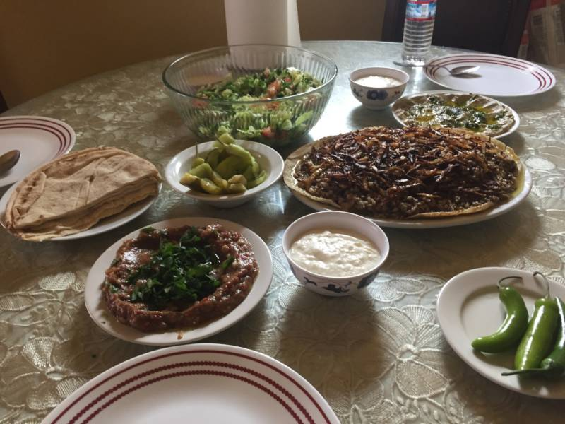 Rawaa Kasedah hopes to teach Syrian cooking classes and eventually open a Syrian restaurant that will feature dishes like mujaddara, shown here. It's a classic meal that consists of lentils, bulgur, and fried onions. Kasedah accompanies the dish with baba ganoush, salad, yogurt, and homemade pickles.