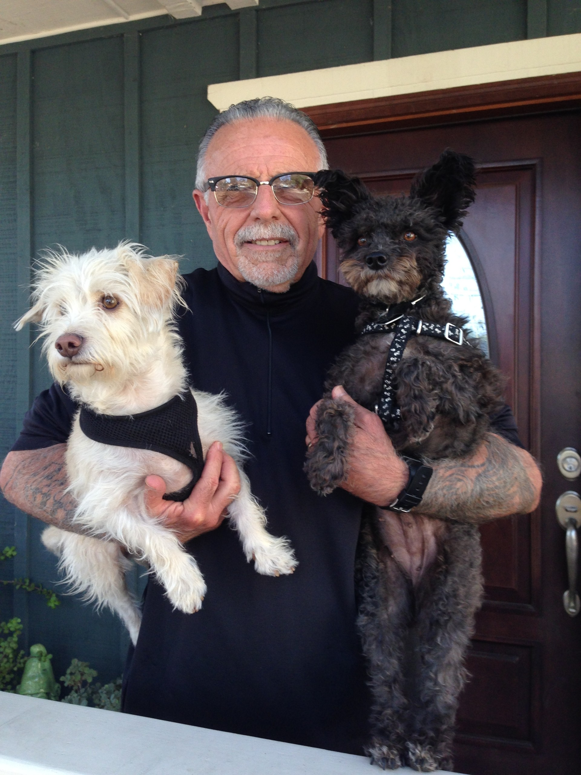 Former Hells Angel George Christie on his Ojai front porch with dogs Mr. Scruffy (L) and Lulu.