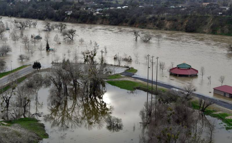 Riverbend Park is seen under flood water in Oroville, California on February 13, 2017. .Almost 200,000 people were under evacuation orders in northern California Monday after a threat of catastrophic failure at the United States' tallest dam. Officials said the threat had subsided for the moment as water levels at the Oroville Dam, 75 miles (120 kilometers) north of Sacramento, have eased. But people were still being told to stay out of the area.